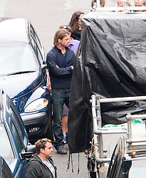 """Brad Pitt on the set of the movie """"World War Z"""" being shot in the city centre of Glasgow. The film, which is set in Philadelphia, is being shot in various parts of Glasgow, transforming it to shoot the post apocalyptic zombie film."""
