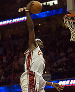 PHOTO BY DAVID RICHARD.LeBron James goes up for a slam dunk against Charlotte.