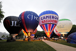 © Licensed to London News Pictures. 05/08/2014; Bristol, UK.  Press launch at Queens Square for the 36th Bristol International Balloon Fiesta which takes place from Thursday 07 August to Sunday 10 August.  Hot air balloons inflated but did not take off due to poor weather conditions.<br /> Photo credit: Simon Chapman/LNP