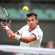 LONDON, ENGLAND - JULY 15:  Mate Pavic of Croatian in action, along with Oliver Marach of Austria in the Men's Doubles Final on Center Court during the Wimbledon Lawn Tennis Championships at the All England Lawn Tennis and Croquet Club at Wimbledon on July 15, 2017 in London, England. (Photo by Tim Clayton/Corbis via Getty Images)