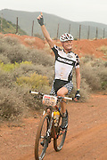 Soren Nissen of Team iHUS still happy even after losing his partner before stage 1 of the 2014 Absa Cape Epic Mountain Bike stage race held from Arabella Wines in Robertson, South Africa on the 24 March 2014<br /> <br /> Photo by Greg Beadle/Cape Epic/SPORTZPICS