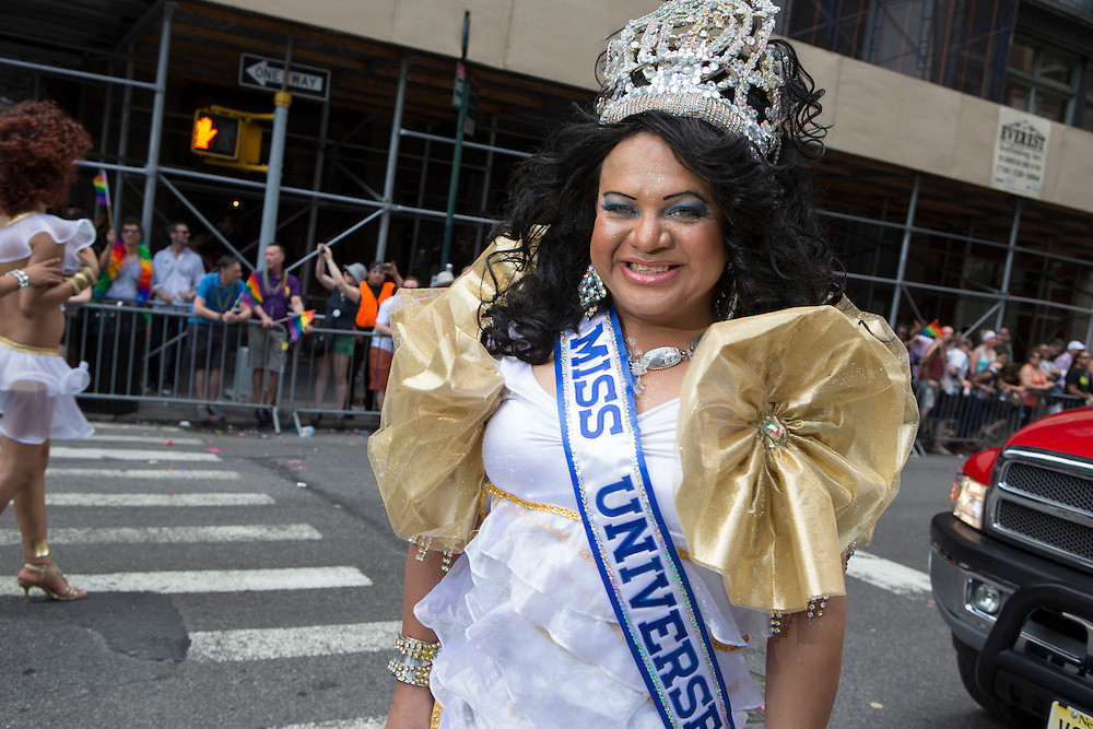 A transgendered marcher with Translatina wears a Miss Universe sash.