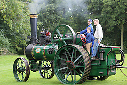 "© Licensed to London News Pictures. 06/10/2013. Steam train enthusiasts made the most of today's glorious autumn sunshine at the Bredhar and Wormshill Light Railway open day. The privately owned steam train light railway is a delightful 2 foot gauge line tucked away in the heart of the Kent countryside, England, near the village of Bredgar in a richly wooded area of the North Kent Downs. The railway  has two stations, a level crossing and over a dozen locomotives including the 100-year-old ""Eigiau"".  Credit : Rob Powell/LNP"