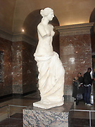 Venus de Milo, is an ancient Greek statue and one of the most famous works of ancient Greek sculpture. Created at some time between 130 and 100 BC, it is believed to depict Aphrodite (Venus to the Romans) the Greek goddess of love and beauty. It is a marble sculpture, slightly larger than life size at 203 cm (6 ft. 8 in) high. Its arms and original plinth have been lost. From an inscription that was on its plinth. It is at present on display at the Louvre Museum in Paris.