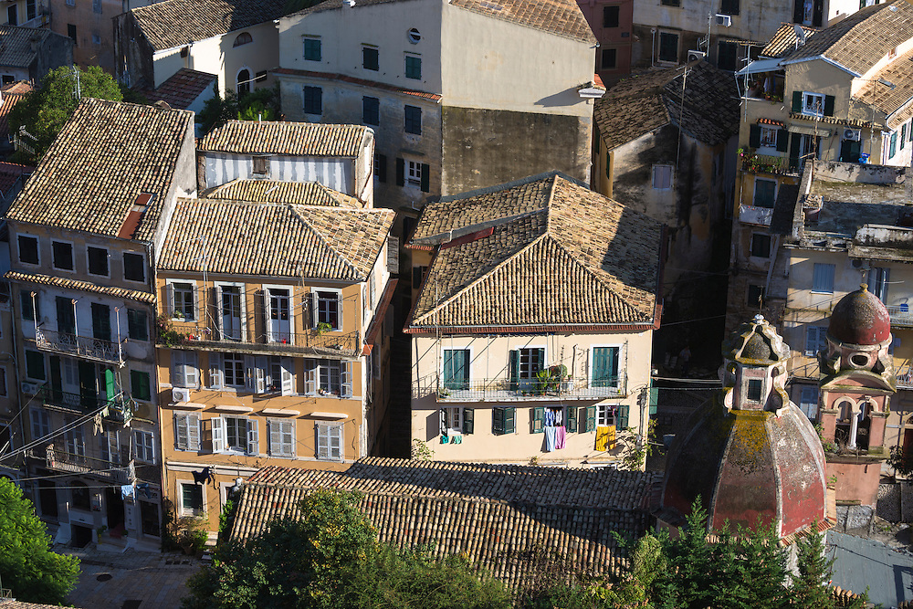 Church domes, homes with washing lines among rooftops in Kerkyra, Corfu Town, Greece