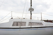 Details of a small yacht on sale on the Thames estuary at Leigh creek in Old Leigh, on 10th September 2019, in Leigh-on-Sea, Essex, England.