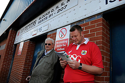 Bristol City fans wait outside Spotland Stadium  - Photo mandatory by-line: Dougie Allward/JMP - Mobile: 07966 386802 23/08/2014 - SPORT - FOOTBALL - Manchester - Spotland Stadium - Rochdale AFC v Bristol City - Sky Bet League One