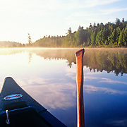 Canoe at sunrise on Northern Roach Pond. Maine