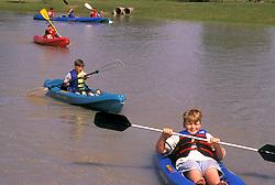 Stock photo of children kayaking