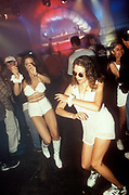 Two women dressed in white hot pants and tops raving at Desire in Sanctuary, Milton Keynes, U.K