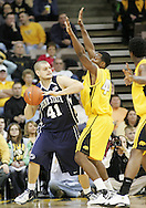 24 JANUARY 2007: Penn State forward Milos Bogetic (41) tries to pass while being guarded by Iowa forward Cyrus Tate (44) in Iowa's 79-63 win over Penn State at Carver-Hawkeye Arena in Iowa City, Iowa on January 24, 2007.