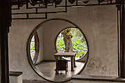 Round doorways in the Secluded Pavilion of Firmiana Humble Administrator's garden in Suzhou, China.