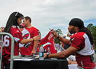 Jul. 28, 2012; Flagstaff, AZ, USA; Arizona Cardinals wide receiver Larry Fitzgerald (11) signs autographs prior to practice at training camp on the campus of Northern Arizona University.  Mandatory Credit: Jennifer Stewart-US PRESSWIRE.