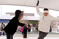 Kayla Shackelford, 11 (left) and Maggie Hydler,  both of Huber Heights during a session with mascot Parker the Penguin on the ice at the RiverScape MetroPark in downtown Dayton, Sunday, January 22, 2012.