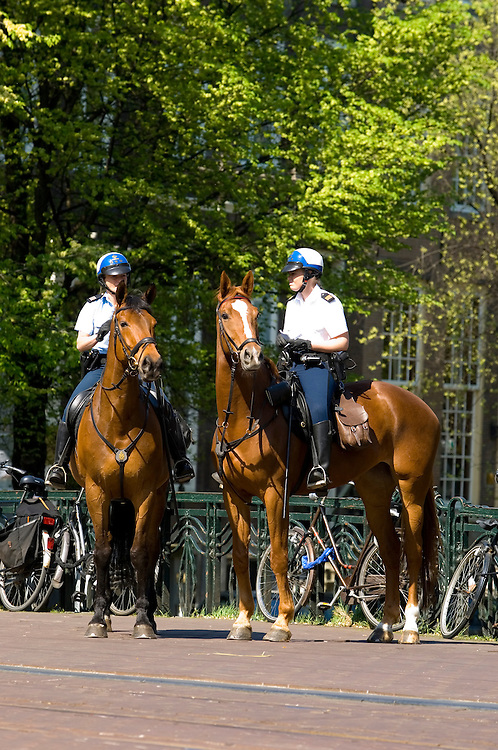 Dutch mounted police officers on duty in the centre of Amsterdam, Holland.