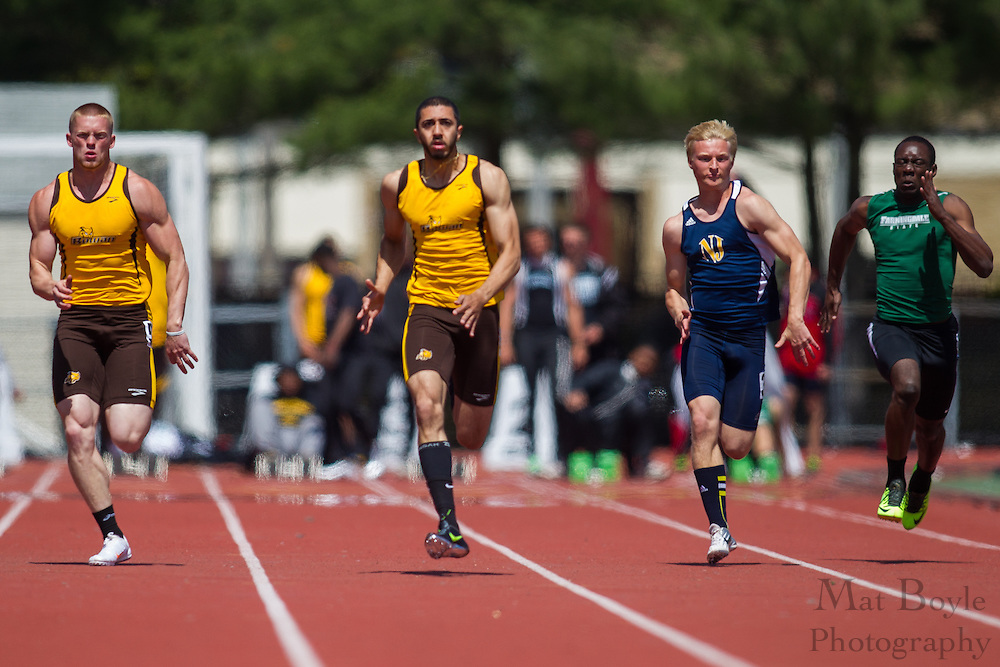 Rowan University freshman Tyler Coulbourn and senior Ali Ejaz (right) competes in the 100 meter dash at the NJAC Track and Field Championships at Richard Wacker Stadium on the campus of  Rowan University  in Glassboro, NJ on Sunday May 5, 2013. (photo / Mat Boyle)