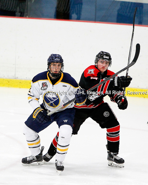GEORGETOWN, ON - Oct 10, 2015 : Ontario Junior Hockey League game action between Buffalo and Georgetown, David Baskerville #21 battles for position during the second period.<br /> (Photo by Brian Watts / OJHL Images)
