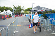 Competitors Check-In their bikes for racking in transition one. Saturday. 2013 Ironman Cairns Triathlon Festival. Cairns, Queensland, Australia. 08/06/2013. Photo By Lucas Wroe