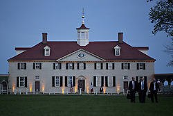 The Mansion at the Mount Vernon estate of first U.S. President George Washington stands during a dinner between U.S. President Donald Trump and Emmanuel Macron, France's president, not pictured, in Mount Vernon, Virginia, U.S., on Monday, April 23, 2018. As Macron arrives for the first state visit of Trump's presidency, the U.S. leader is threatening to upend the global trading system with tariffs on China, maybe Europe too. Photographer: Andrew Harrer/Bloomberg
