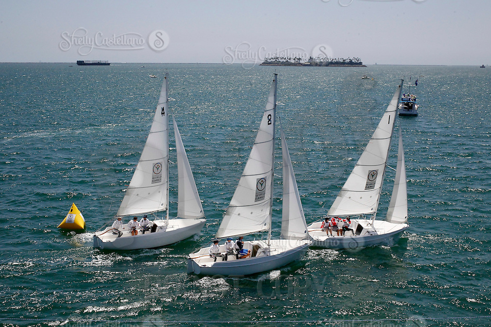 1 August 2015: Special Olympic World Games Los Angeles Sailing Finals in Long Beach, California.  Greece, Russia and USA Cal 20's round a buoy and head to their next mark on the final day of racing in the pacific ocean.