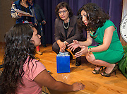 Sonia Nazario, center, and Juliet Stipeche, right, talk with a student after a presentation at Chavez High School, September 26, 2014.