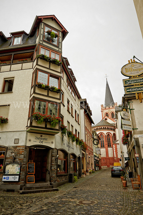 View of a Bacharach street showing pubs, restaurants, and St. Peter Church, Bacharach, Germany.