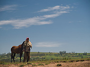 A man and his horse looks on as we build a crossing over the river on our way to Kotoba, Ethiopia.