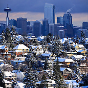 Snow covered Magnolia neighborhood with Seattle, Washington skyline in distance