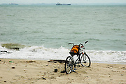 A lone bicycle waits the return of its owner by the beash at East Coast Park, Singapore