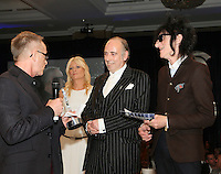 (L-R) Nick Headon, Gabby Roslin, MIck Jones, John Cooper Clark. The Silver Clef Lunch 2013 in aid of Nordoff Robbins held at the London Hilton, Park Lane, London.<br /> Friday, June 28, 2013 (Photo/John Marshall JME)
