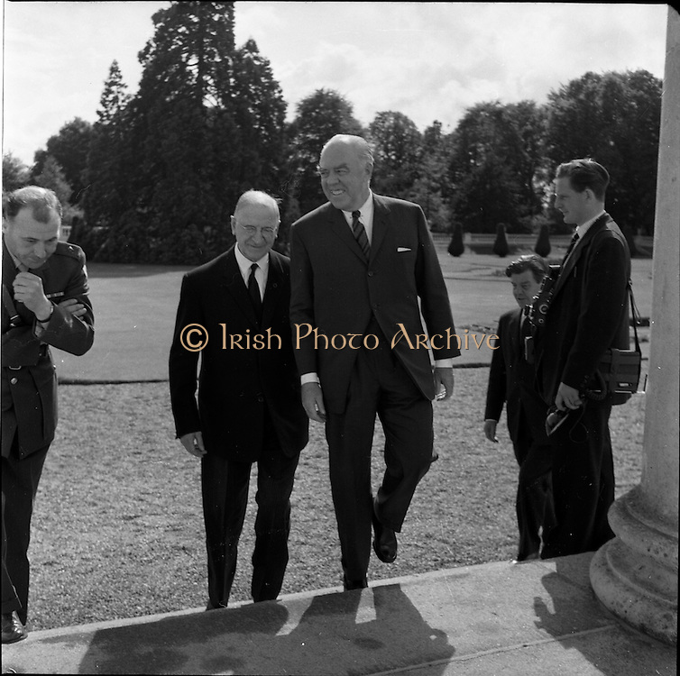 02/08/1962<br /> 08/02/1962<br /> 02 August 1962<br /> Ambassador Oil Co. representatives at Aras an Uachtarain.<br /> Picture shows Mr F. Kirk Johnston, (right) Chairman of Ambassador Oil Corporation and President of Ambassador Irish Oil Co. with President Eamon de Valera.