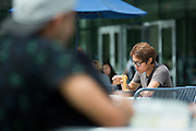 A student eats Panda Express outside the new Student Union West Wing during the first day of classes at San Jose State University in San Jose, California, on August 25, 2014. (Stan Olszewski/SOSKIphoto)