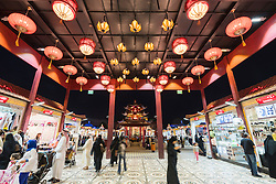 Illuminated China Pavilion at night at Global Village 2015 in Dubai United Arab Emirates