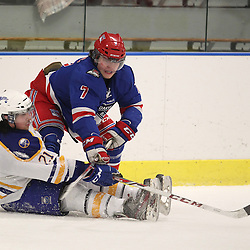Buffalo, NY - Feb 4 : Ontario Junior Hockey League game action between the Buffalo Junior Sabres and the Oakville Blades, Daniel Jelic #7 of the Oakville Blades Hockey Club and Nico Gonzalez #21 of the Buffalo Junior Sabres Hockey Club battle for a loose puck during third period game action. (Photo By Timothy T. Ludwig / OHJL Images)