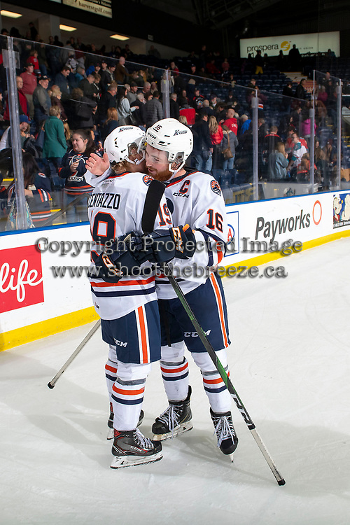 KELOWNA, BC - OCTOBER 12: Team captain Zane Franklin #16 celebrates the win with Orrin Centazzo #19 of the Kamloops Blazers after the win against the Kelowna Rockets at Prospera Place on October 12, 2019 in Kelowna, Canada. (Photo by Marissa Baecker/Shoot the Breeze)
