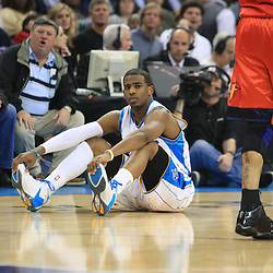 30 January 2009:  New Orleans Hornets guard Chris Paul (3) sits on the court following a foul during a 91-87 loss by the New Orleans Hornets to Golden State Warriors at the New Orleans Arena in New Orleans, LA.