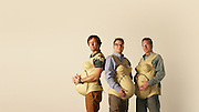 MEET THE DADS WEARING 33-POUND 'EMPATHY BELLIES' TO EXPERIENCE THE PAIN OF BEING 9 MONTHS PREGNANT<br /> <br /> Swollen breasts, the constant urge to wee and broken nights are problems expectant mums know all too well and men have been unable to share - until now.<br /> <br /> So what happened when three dads became nine months pregnant? <br /> <br /> Jason Bramley, Steve Hanson and Jonny Biggins are discovering exactly what it's like to have a baby on board by wearing pregnancy suits to honour mums in the run up to US Mother's Day on Sunday, March 15.<br /> <br /> While most mothers would be happy with a bunch of flowers, the married dads, who are behind a new personalised Mother's Day book called Book Of Mum, are wearing pregnancy suits all day every day for a month.<br /> <br /> Steve, 46, who is married to Kate and has a 12-year-old son, called Saul, said: 'Every day things like putting on your socks becomes a monumental task.'<br /> <br /> The trio, who are from England but all work at an office in Barcelona, are wearing their bumps to work, to the pub and to bed and are only allowed to remove them to wash.<br /> <br /> Jason, 44, who is a father-of-one mused on day five: 'I wonder why pregnant women don't use wheelchairs.'<br /> <br /> But it's not all fun and games.<br /> <br /> The 'empathy belly' comes complete with fake breasts and weighs two and a half stone - the average weight of a full term baby bump.<br /> <br /> It is designed to put pressure on the bladder, stomach and lungs, and cause abdominal distention and the inability to get comfortable.<br /> <br /> 'On day three I didn't sleep a wink, I just couldn't get settled,' said company dirctor Steve, from Doncaster.  <br /> <br /> 'I tried to make a small city out of pillows around my bump. My boobs, which at first were quite a pleasurable novelty, soon became about as welcome as a fart in a spacesuit,' he added.<br /> <br /> 'They were way too warm and hung on my arm, sending it to sleep and waking 