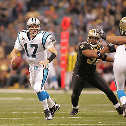 2008 December, 28: Carolina Panthers quarterback Jake Delhomme (17) runs away from New Orleans Saints defensive end Will Smith (91) during a week 17 game between NFC South divisional rivals the Carolina Panthers and the New Orleans Saints at the Louisiana Superdome in New Orleans, LA.