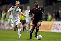 Fotball<br /> Nederland<br /> Foto: ProShots/Digitalsport<br /> NORWAY ONLY<br /> <br /> FC København v Ajax<br /> Koperhagen , 09-08-2006 , voorronde Champions League , FC Kopenhagen - Ajax , 1-2 , Martin Bergvold in duel met Ryan Babel