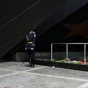 An Ukrainian policeman takes guard during a ceremony that marks 69 years since the Soviets defeated the Nazis, at the War Memorial in central Donetsk, amid tensions over the referendum for autonomy of the region to be held over the weekend.