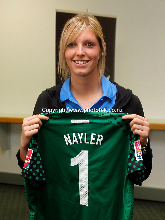 New Zealand Football's High Performance Manager Fred De Jong presents Erin nayler with her shirt. New Zealand Football present playing shirts to the Junior Football Ferns ahead of their departure to Japan for the FIFA U-20 Women's World Cup, North Harbour Stadium, Tuesday 7th August 2012. Photo: Shane Wenzlick