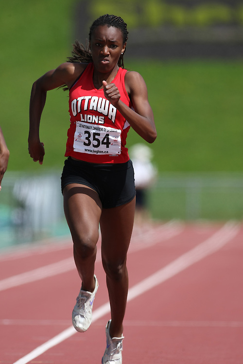 (Sherbrooke, Quebec---10 August 2008) Gift Okankwu competing in the 200m at the 2008 Canadian National Youth and Royal Canadian Legion Track and Field Championships in Sherbrooke, Quebec. The photograph is copyright Sean Burges/Mundo Sport Images, 2008. More information can be found at www.msievents.com.