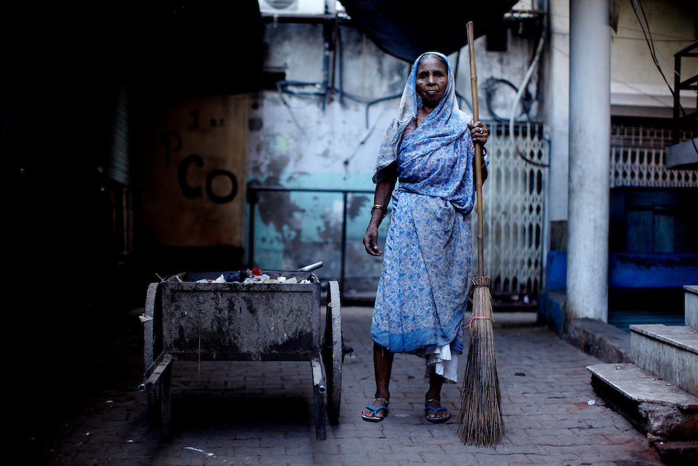 "Kalawati is dalit. She is unsure of her own age, but certain that she is more than 50. The pride she take in her broomstick and her job sweeping garbage and digging through human shit is evident in her resilient posture. For 35 years she has been doing this early morning work; making the city ready for its 'real people""...Photo by: Eivind H. Natvig/MOMENT"