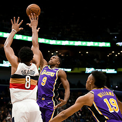 Mar 31, 2019; New Orleans, LA, USA; Los Angeles Lakers guard Rajon Rondo (9) shoots over New Orleans Pelicans center Jahlil Okafor (8) during the second quarter at the Smoothie King Center. Mandatory Credit: Derick E. Hingle-USA TODAY Sports