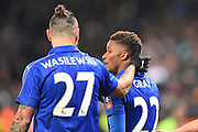Leicester City defender Marcin Wasilewski (27) congratulates Leicester City midfielder Demarai Gray (22) after scores a goal to make it 3-1 during The FA Cup fourth round replay match between Leicester City and Derby County at the King Power Stadium, Leicester, England on 8 February 2017. Photo by Jon Hobley.