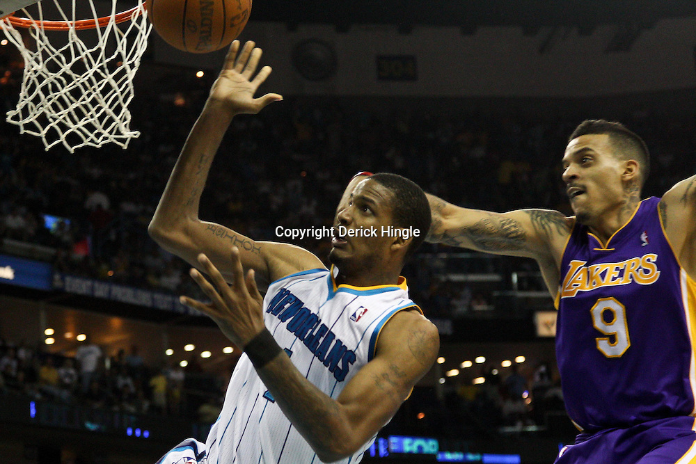 April 24, 2011; New Orleans, LA, USA; New Orleans Hornets small forward Trevor Ariza (1) is fouled by Los Angeles Lakers small forward Matt Barnes (9) during the fourth quarter in game four of the first round of the 2011 NBA playoffs at the New Orleans Arena. The Hornets defeated the Lakers 93-88.   Mandatory Credit: Derick E. Hingle