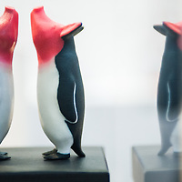 3D printed glossy pigs models are on display at the 3D Printshow at the Old Billingsgate in London. 3D Printshow brings together the biggest names in 3D printing technology alongside the most creative, exciting and innovative individuals using additive processes today.