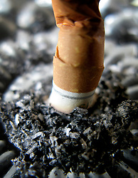 Embargoed to 0001 Saturday July 1 Undated file photo of a cigarette stubbed out in an ashtray. Health campaigners are celebrating the 10th anniversary of smoke-free legislation in England, saying it has had one of the biggest impacts on public health over the last decade.