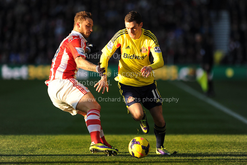 Sunderland's Adam Johnson ® is challenged by Stoke's Murko Arnautovic. Barclays Premier league, Stoke city v Sunderland at the Britannia stadium in Stoke on Trent, England on Saturday 23rd Nov 2013. pic by Andrew Orchard, Andrew Orchard sports photography,