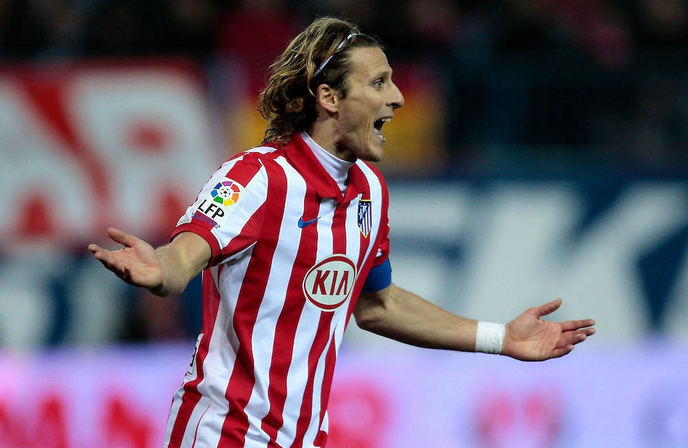 Atletico de Madrid's Diego Forlan from Uruguay, reacts during his Spanish Copa del Rey soccer match against Celta de Vigo at the Vicente Calderon stadium in Madrid, Thursday, Jan. 21, 2010.
